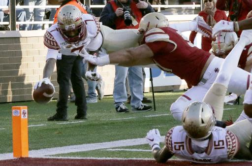 Florida State wide receiver D.J. Matthews (7) dives to the pylon for a touchdown against Boston College after catching a pass in the second half of an NCAA college football game, Saturday, Nov. 9, 2019, in Boston. (AP Photo/Bill Sikes)