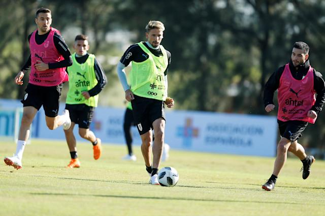 Football Soccer - World Cup 2018 - Uruguay's national soccer team training - Montevideo, Uruguay - May 24, 2018 - Gaston Ramirez, Matias Vecino and Nicolas Lodeiro of Uruguay during a training session. REUTERS/Andres Stapff