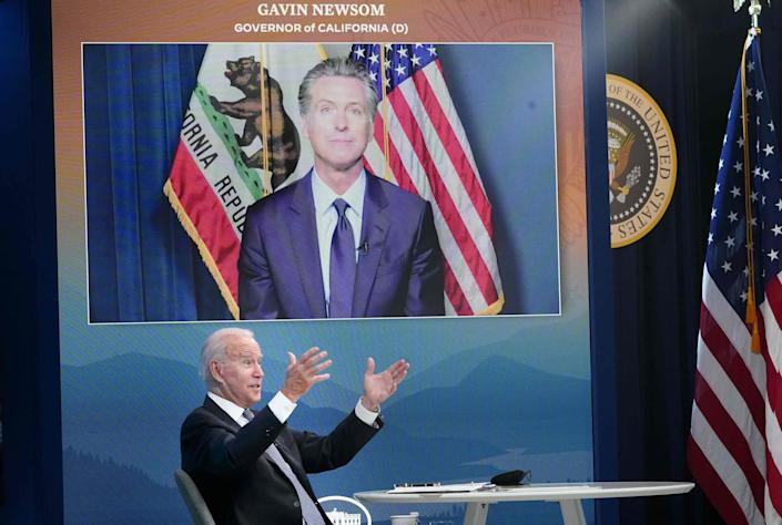 President Joe Biden speaks as California Governor Gavin Newsom. on a screen, looks on during a meeting with state governors in Washington, DC on July 30, 2021.