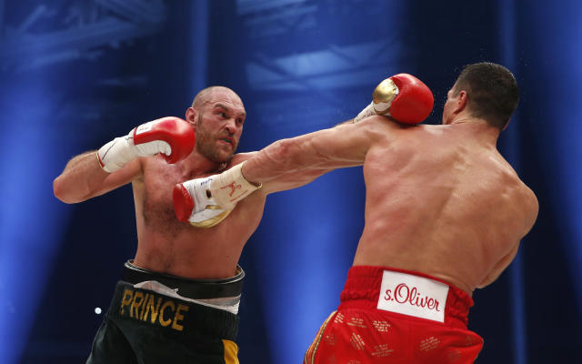 Boxing - Wladimir Klitschko v Tyson Fury WBA, IBF & WBO Heavyweight Title's - Esprit Arena, Dusseldorf, Germany - 28/11/15 Tyson Fury in action against Wladimir Klitschko during the fight Action Images via Reuters / Lee Smith Livepic