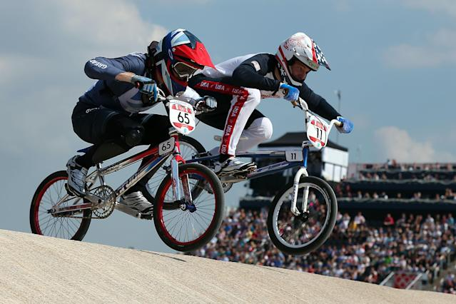 LONDON, ENGLAND - AUGUST 09: Liam Phillips (L) of Great Britain and Connor Fields of the United States race through the course during the Men's BMX Cycling Quarter Finals on Day 13 of the London 2012 Olympic Games at BMX Track on August 9, 2012 in London, England. (Photo by Bryn Lennon/Getty Images)