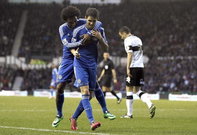 Chelsea's Oscar, right, celebrates scoring a goal with teammate Willian, left, during the English FA Cup third round soccer match between Derby County and Chelsea at the iPro Stadium in Derby, England, Sunday, Jan. 5, 2014. (AP Photo/Kirsty Wigglesworth)