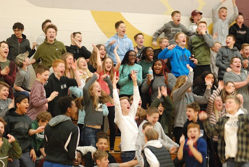 Spectators cheer at a Unified Sports basketball game.