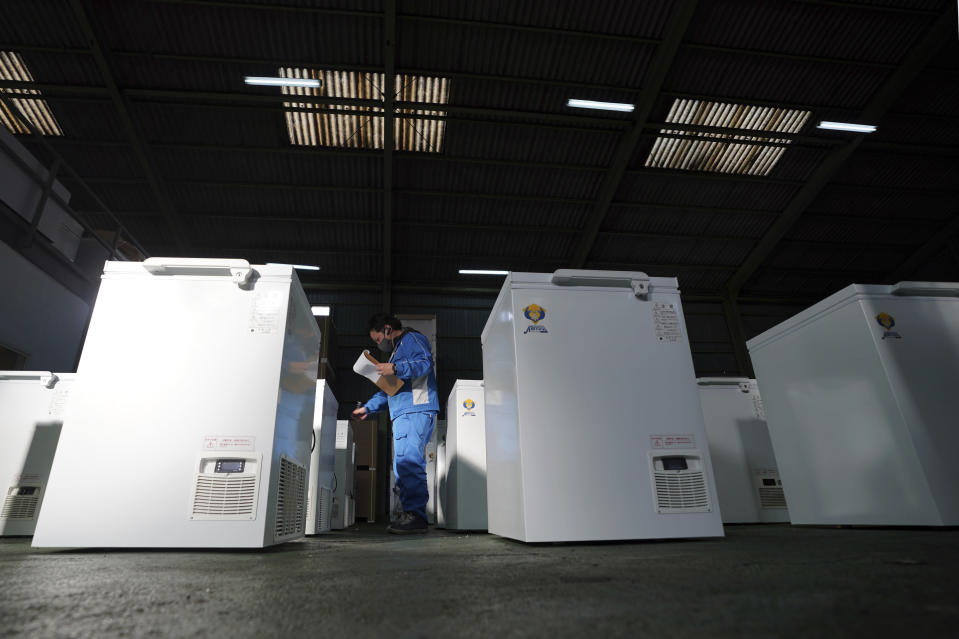 Brand-new ultralow-temperature freezers are seen at warehouse at Kanou Reiki, a freezer supplier, on Friday, Jan. 22, 2021 in Sagamihara, west of Tokyo. Some of COVID-19 vaccine must be kept at the ultra-cold temperature of around -70 degrees Celsius (-94 degrees Fahrenheit). Japan is accelerating preparations for COVID-19 vaccinations in hopes of starting them in late February, but uncertainty is growing as the country faces vaccine-shy public, slow approval process and bureaucratic roadblocks, casting a doubt if Tokyo Olympic this summer is possible. (AP Photo/Eugene Hoshiko)
