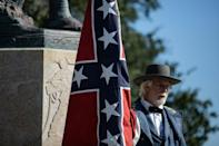 """Braxton Spivey describes himself as a """"living historian"""" who supports display of the Confederate battle flag as a way to honor souther Civil War soldiers, but critics call him racist"""