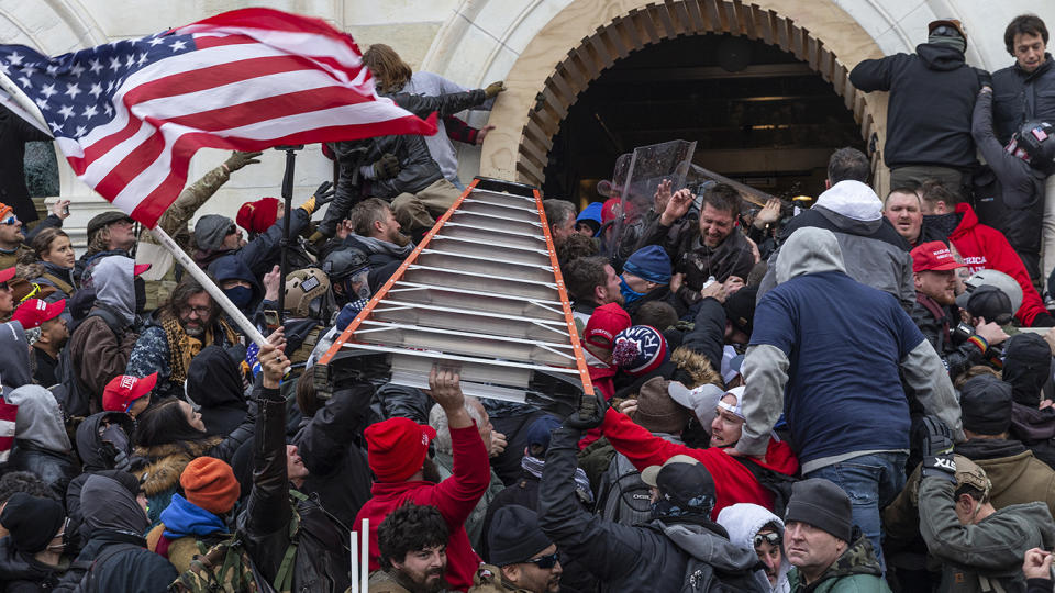 Rioters clash with police using big ladder trying to enter Capitol building through the front doors on Jan. 6, 2020 in Washington, D.C. (Lev Radin/Pacific Press/LightRocket via Getty Images)