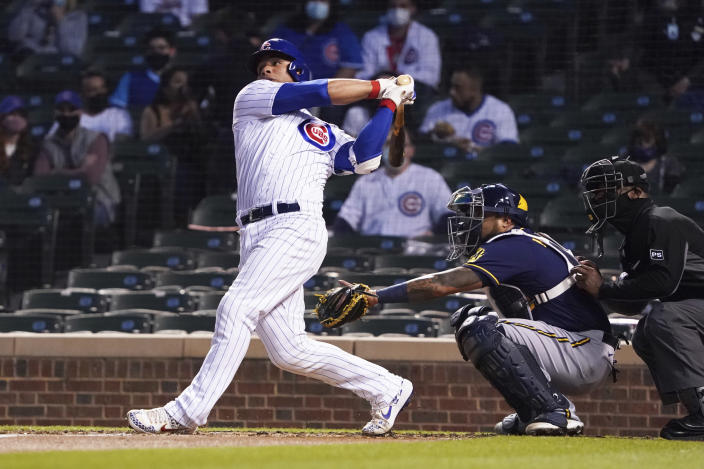 Chicago Cubs' Willson Contreras hits a two-run home run against the Milwaukee Brewers during the fourth inning of a baseball game, Monday, April 5, 2021, in Chicago. (AP Photo/David Banks)