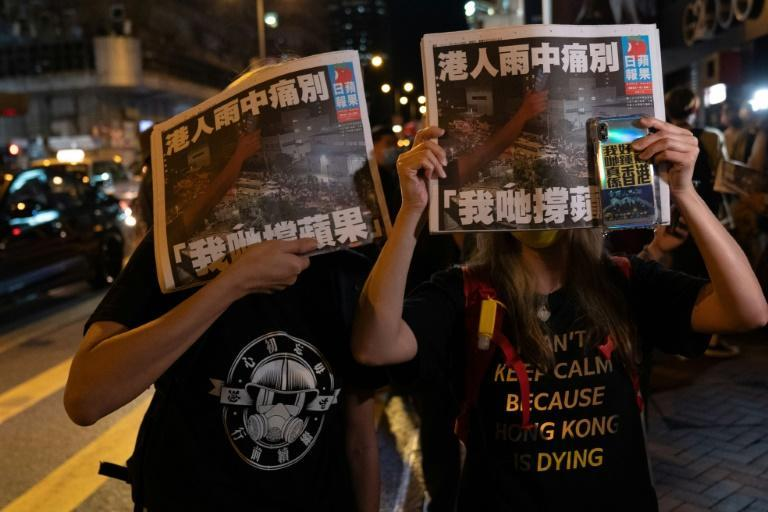 Hong Kong's pro-democracy tabloid Apple Daily has been forced to close under a new national security law