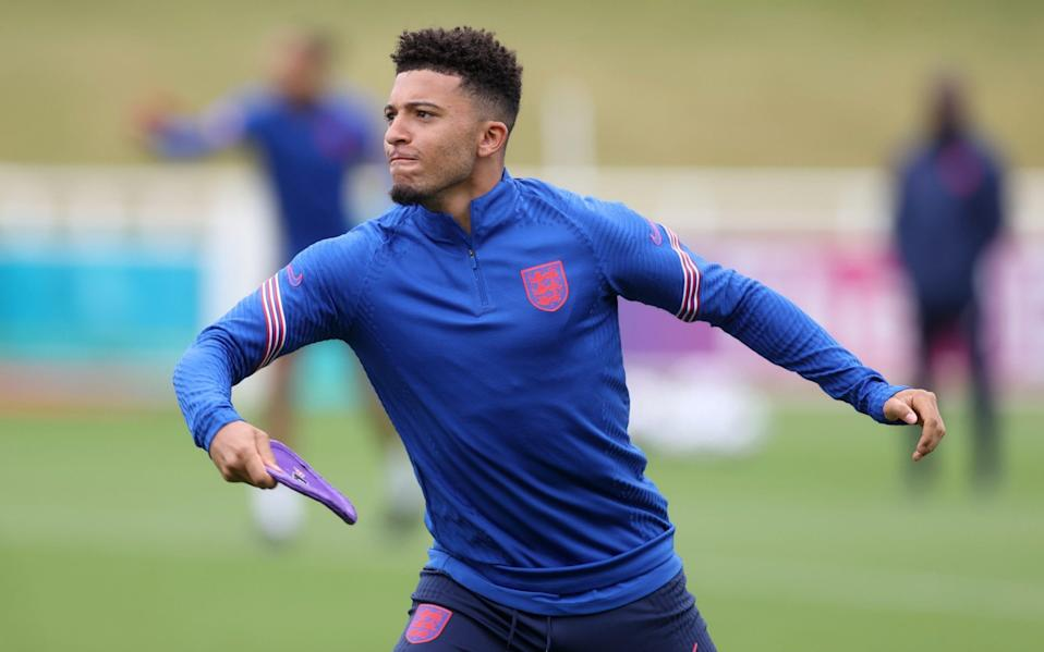 Sancho with a frisbee at England training - REUTERS