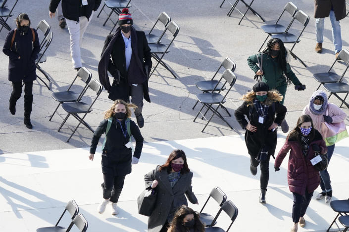 People evacuate from the West Front of the U.S. Capitol during a rehearsal the 59th Presidential Inauguration at the U.S. Capitol in Washington, Monday, Jan. 18, 2021. (AP Photo/Carolyn Kaster)