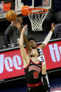 Minnesota Timberwolves forward Jaden McDaniels (3) blocks a shot by Chicago Bulls guard Zach LaVine (8) in the first quarter of an NBA basketball game, Sunday, April 11, 2021, in Minneapolis. (AP Photo/Andy Clayton-King)
