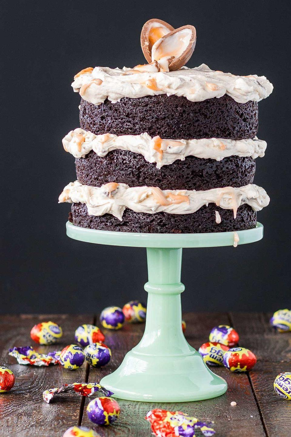 """<p>Slice a Cadbury Creme Egg in half to make the ultimate cake topper. The more white and yellow cream that oozes out, the better! </p><p><em><a href=""""https://livforcake.com/cadbury-creme-egg-cake/"""" rel=""""nofollow noopener"""" target=""""_blank"""" data-ylk=""""slk:Get the recipe from Liv for Cake »"""" class=""""link rapid-noclick-resp"""">Get the recipe from Liv for Cake »</a></em> </p>"""