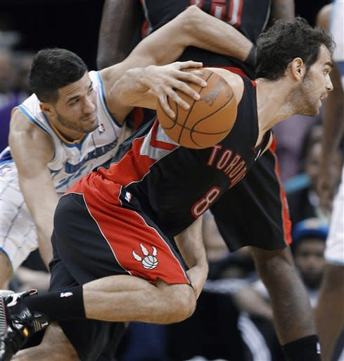 Toronto Raptors guard Jose Calderon (8) breaks to the basket as New Orleans Hornets guard Greivis Vasquez (21) gets caught on a screen in the first half of an NBA basketball game in New Orleans, Wednesday, Feb. 29, 2012. (AP Photo/Bill Haber)