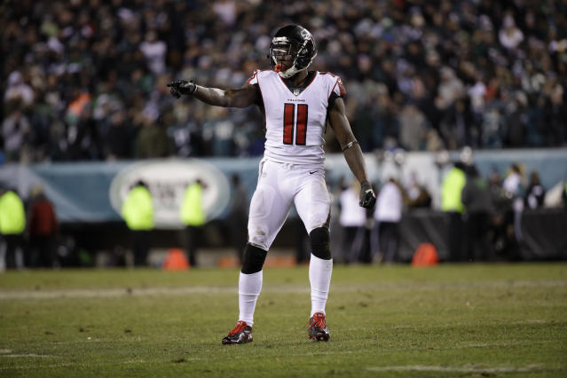 Time to pay up? Atlanta Falcons receiver Julio Jones is skipping this week's manditory mini-camp; he reportedly wants a change to his contract. (AP)
