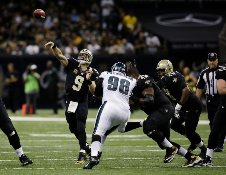 New Orleans Saints quarterback Drew Brees (9) passes as Philadelphia Eagles defensive tackle Mike Patterson (98) rushes during the second half an NFL football game at the Mercedes-Benz Superdome in New Orleans, Monday, Nov. 5, 2012. The Saints won 28-13. (AP Photo/Bill Haber)