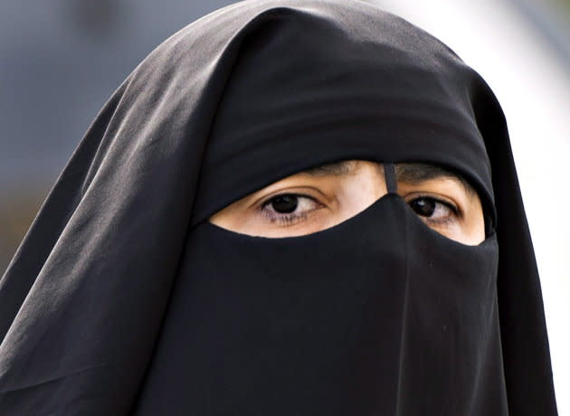 A woman wears a niqab as she walks in Montreal on Sept. 9, 2013.
