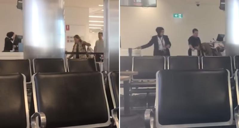 A Jetstar crew member ushers a family of four running late for a flight to Bali from Sydney onto the plane.