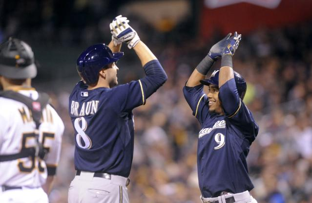 PITTSBURGH, PA - APRIL 19: Ryan Braun #8 of the Milwaukee Brewers is congratulated by Jean Segura # 9 after his second home run against the Pittsburgh Pirates gave the Brewers a 8-7 lead in the ninth inning at PNC Park on April 19, 2014 in Pittsburgh, Pennsylvania. (Photo by Vincent Pugliese/Getty Images)