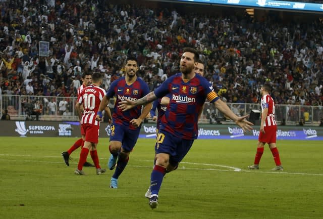 Lionel Messi scored for Barcelona but later saw an effort disallowed by VAR (Amr Nabil/AP)