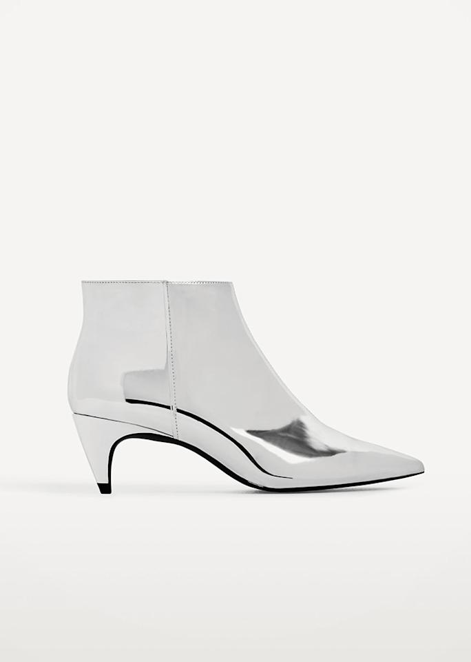 "Zara Silver High Heel Ankle Booties, $34.95 (was $69.90); at <a rel=""nofollow"" href=""http://www.zara.com/us/en/woman/mid-season-%7C-50-off/faux-leather-mini-skirt-c818525p4202161.html"" rel="""">Zara</a>"