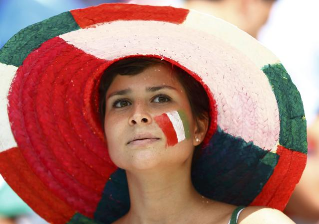A fan of Italy with an image of the national flag painted on her face, is pictured before their 2014 World Cup Group D soccer match against Costa Rica at the Pernambuco arena in Recife June 20, 2014. REUTERS/Dominic Ebenbichler (BRAZIL - Tags: SOCCER SPORT WORLD CUP)