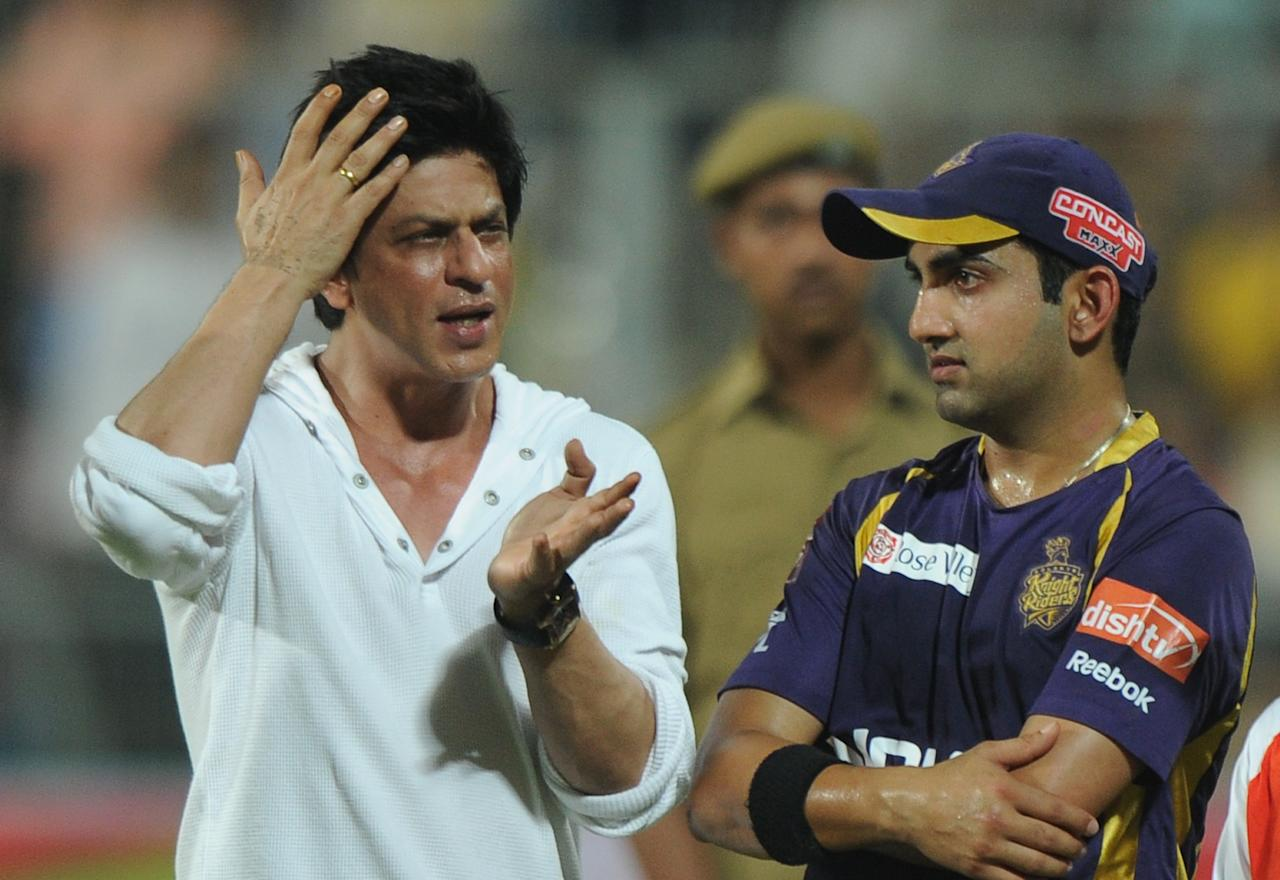 Bollywood actor and Kolkata Knight Riders co-owner Shah Rukh Khan (C) talks with team captain Gautam Gambhir after the IPL Twenty20 cricket match between Kolkata Knight Riders and Pune Warriors India at The Eden Gardens in Kolkata on May 5, 2012.  RESTRICTED TO EDITORIAL USE. MOBILE USE WITHIN NEWS PACKAGE.  AFP PHOTO/Dibyangshu SARKAR        (Photo credit should read DIBYANGSHU SARKAR/AFP/GettyImages)