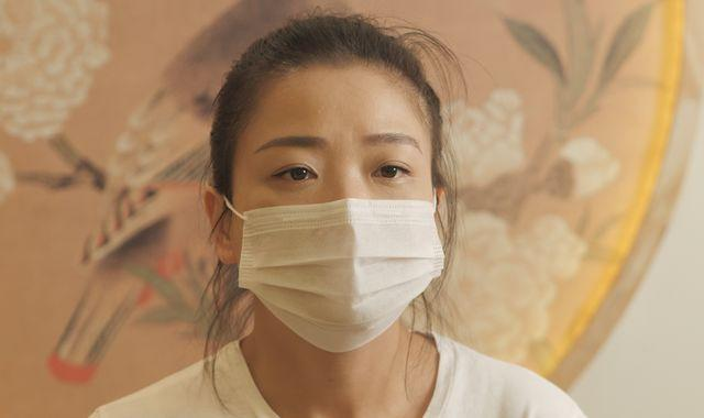 Coronavirus: This Wuhan woman is suing China - and wants an apology after her father died of COVID-19