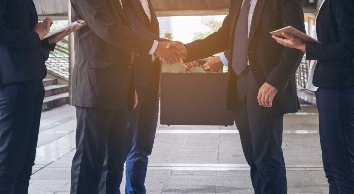 Image of two business people shaking hands
