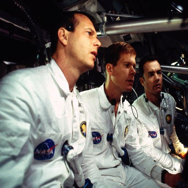 Fred Haise, Jack Swigert, and Jim Lovell wearing their NASA uniforms in the space shuttle in Apollo 13