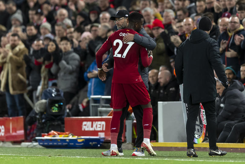 LIVERPOOL, ENGLAND - DECEMBER 04: Liverpool Manager Jurgen Klopp congratulates Divock Origi of Liverpool as he is substituted during the Premier League match between Liverpool FC and Everton FC at Anfield on December 4, 2019 in Liverpool, United Kingdom. (Photo by Daniel Chesterton/Offside/Offside via Getty Images)