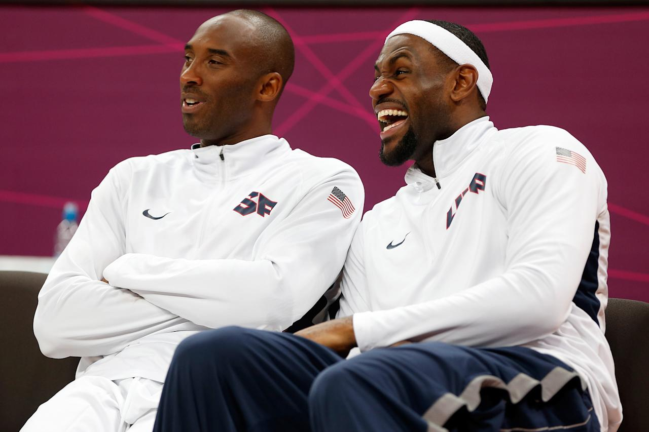 LONDON, ENGLAND - JULY 29:  Kobe Bryant #10 and LeBron James #6 of the United States smile while on the bench against France in the Men's Basketball Game on Day 2 of the London 2012 Olympic Games at the Basketball Arena on July 29, 2012 in London, England.  (Photo by Jamie Squire/Getty Images)
