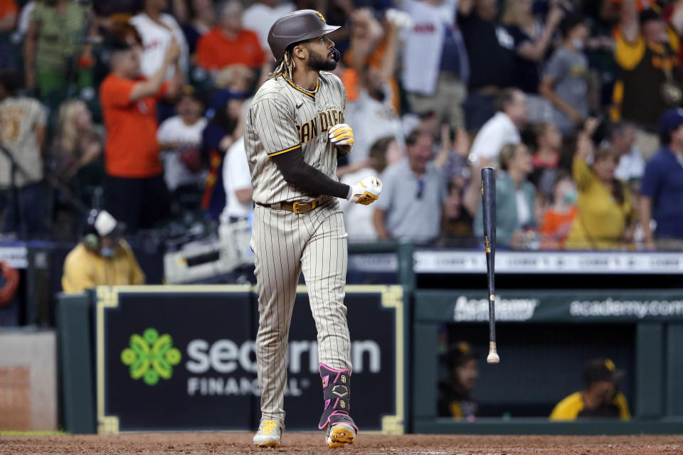 San Diego Padres designated hitter Fernando Tatis Jr. flips his bat as he watches his three-run home run against the Houston Astros during the ninth inning of a baseball game Saturday, May 29, 2021, in Houston. (AP Photo/Michael Wyke)