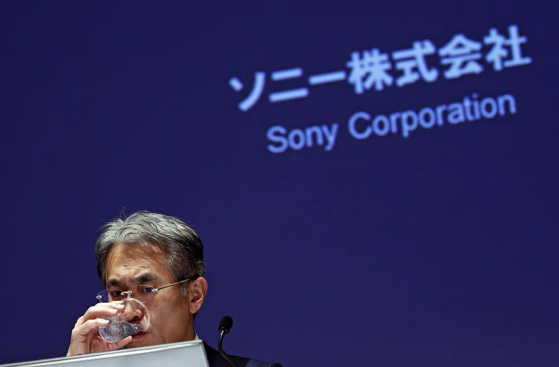 Sony Corp's Chief Financial Officer Yoshida drinks a glass of water during a news conference in Tokyo