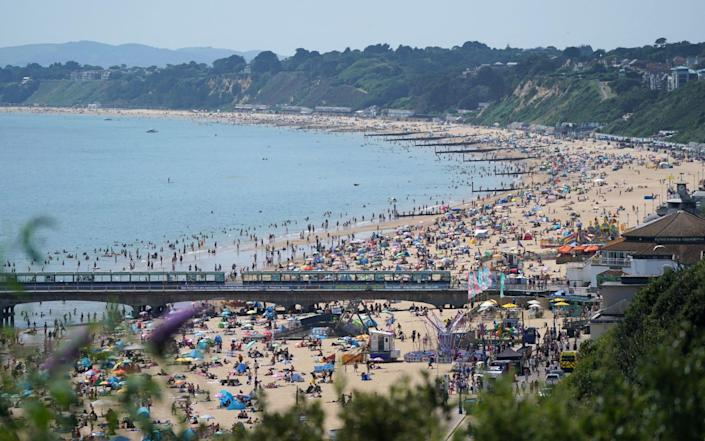 People enjoying the hot weather at Bournemouth Beach in Dorset on July 20 - Andrew Matthews/PA Wire