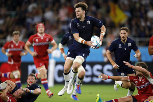 Scotland's Duncan Taylor passes the ball during the Rugby World Cup Pool A game at Shizuoka Stadium Ecopa between Scotland and Russia in Shizuoka, Japan, Wednesday, Oct. 9, 2019. (AP Photo/Christophe Ena)