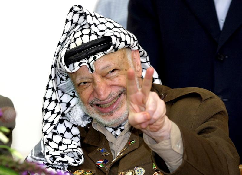 Late Palestinian leader Yasser Arafat pictured in the West Bank city of Ramallah in July 2004 (AFP Photo/Abbas Momani)