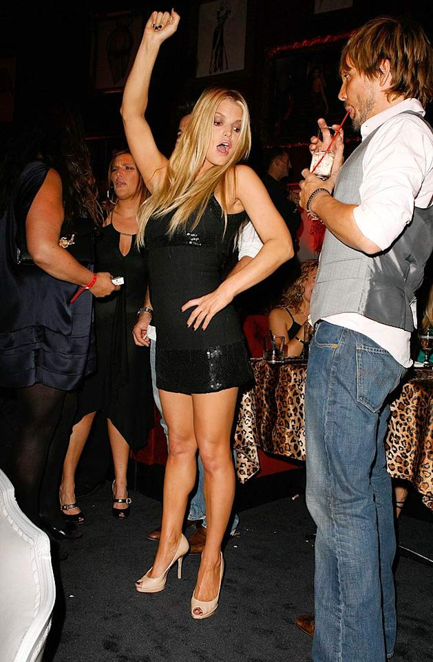 "Celeb hair stylist Ken Paves stares in horror as Jessica Simpson attempts to dance at the Frederick's of Hollywood Fashion Show. The annual event is held to benefit the Clothes Off Our Back Foundation. Jeff Vespa/<a href=""http://www.wireimage.com"" target=""new"">WireImage.com</a> - October 24, 2007"