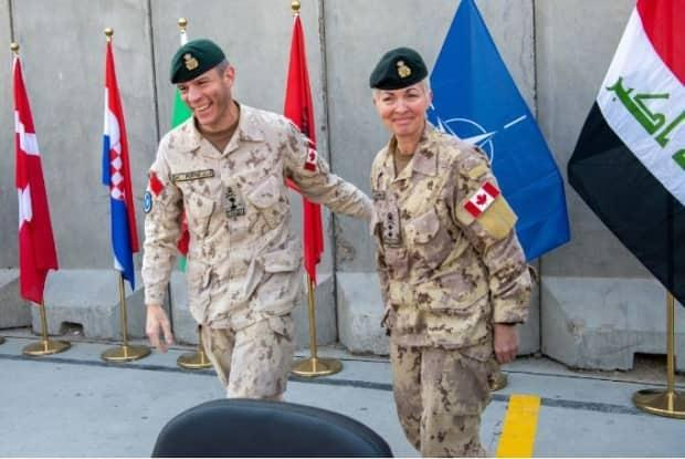Maj.-Gen. Dany Fortin hands over command of the NATO mission in Iraq to then Maj-Gen. Jennie Carignan in Baghdad on Nov. 26, 2020.
