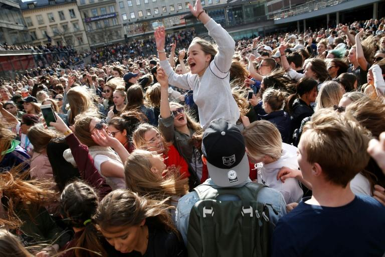 Fans of Swedish DJ Avicii danced to his music at a gathering in Stockholm on Saturday