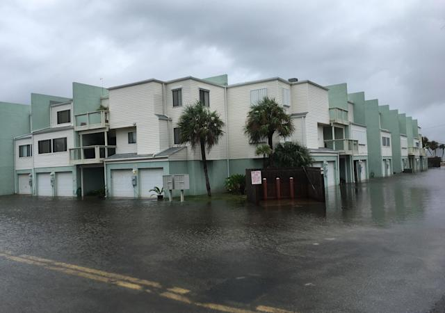 <p>Floodwaters surround a condo in the aftermath of Tropical Storm Nate on Sunday Oct. 8, 2017, in Pensacola Beach. (Photo: Brendan Farrington/AP) </p>