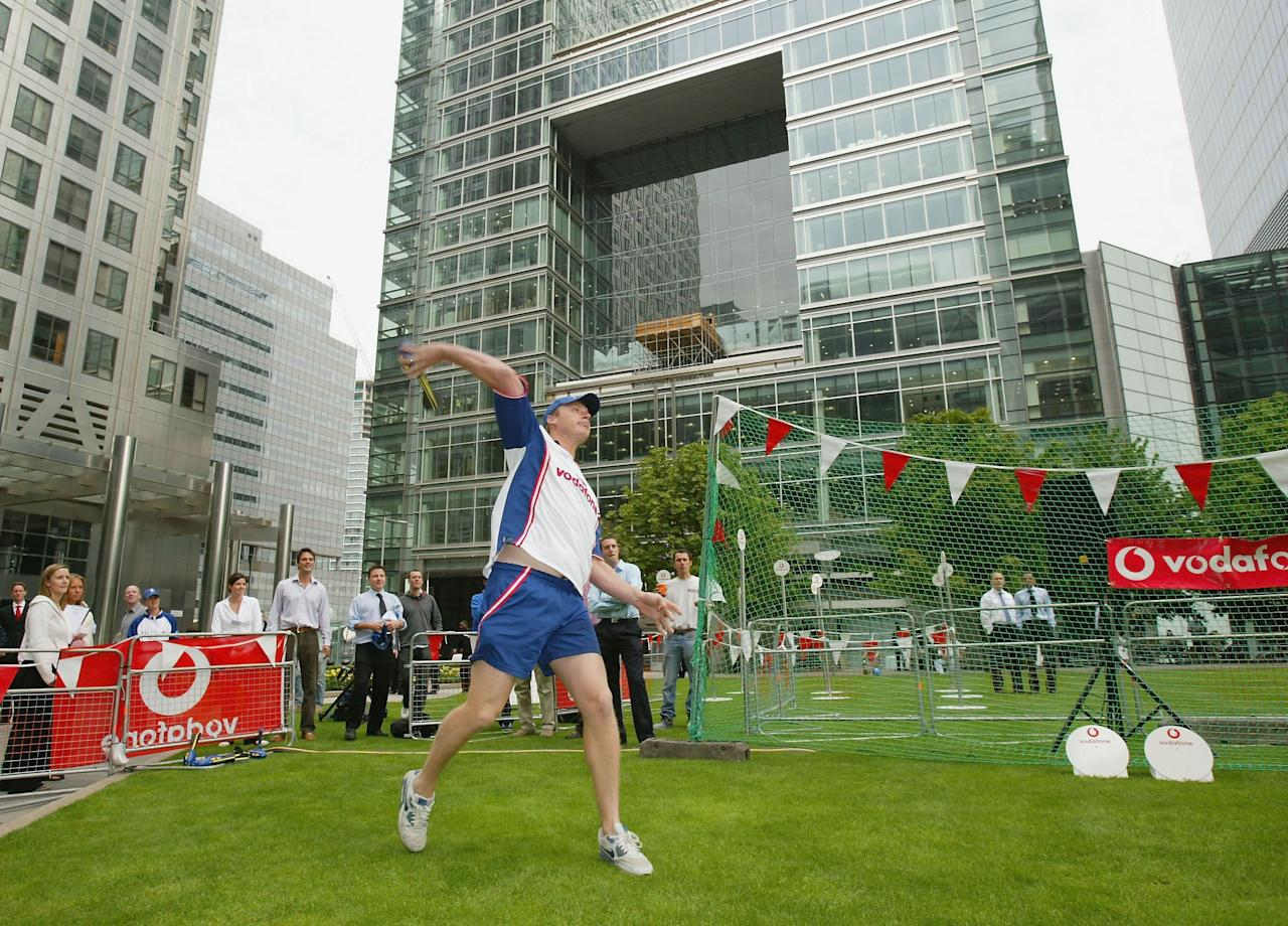 LONDON - SEPTEMBER 2:  Andrew Flintoff of England throws a Vortex ball before the public challenge his throw during the Vodafone Challenge Andrew Flintoff Competition in Canada Square Gardens on September 2, 2003 in London. (Photo by Christopher Lee/Getty Images for Vodafone)