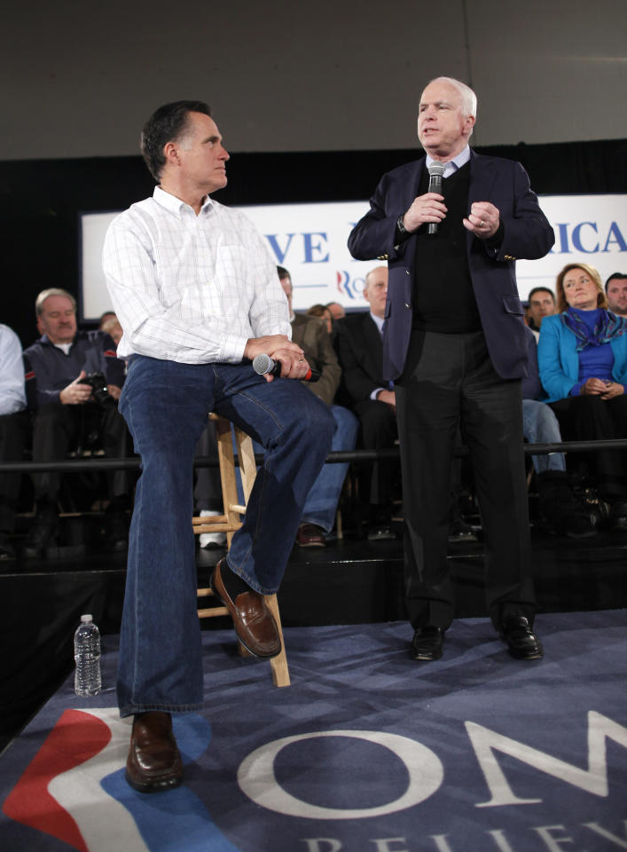 Republican presidential candidate, former Massachusetts Gov. Mitt Romney, campaigns with Sen. John McCain, R-Ariz., at the Boys and Girls Club in Salem, N.H., Thursday, Jan. 5, 2012. (AP Photo/Charles Dharapak)