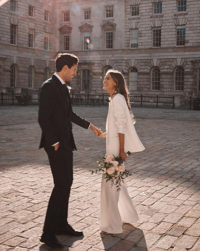 """<p>A six (or 15, or 30)-person strong guest list won't stop couples in love and ready to wed getting hitched, but why should they forgo a party, even if not in the same year?'</p><p>People are not wanting to put their nuptials on hold and with this uncertain future, now more than ever that love is important to be celebrated.' Wilkes details. </p><p>'Couples are choosing to have a small and intimate ceremony to make their marriage official with close loved ones with the plan to hold a larger celebration when the time is right to with the wider family and friends. First anniversary party anyone?'</p><p>Chapman has seen the same, telling ELLE UK: 'Lots of couples are planning their postponed micro wedding for 2021 which will be beautiful and meaningful. But then they are planning a larger celebration with a celebrant ceremony in 2022. In essence they are celebrating twice. And after 2020, why not?'</p><p><a href=""""https://www.instagram.com/p/CHQuCyrh6kf/"""" rel=""""nofollow noopener"""" target=""""_blank"""" data-ylk=""""slk:See the original post on Instagram"""" class=""""link rapid-noclick-resp"""">See the original post on Instagram</a></p>"""
