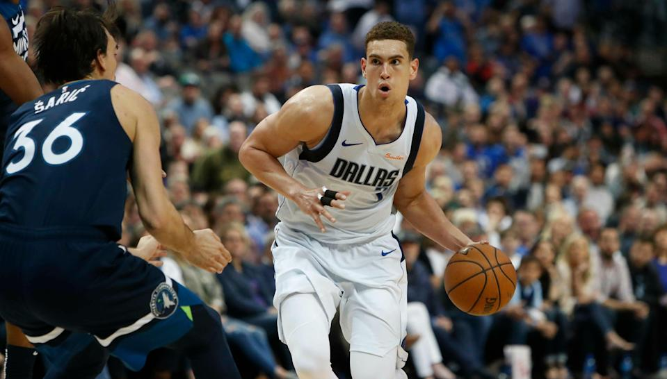 Dallas Mavericks forward Dwight Powell (7) dribbles during the second half of an NBA basketball game in Dallas, Wednesday, April 3, 2019. The Timberwolves won 110-108. (AP Photo/LM Otero)