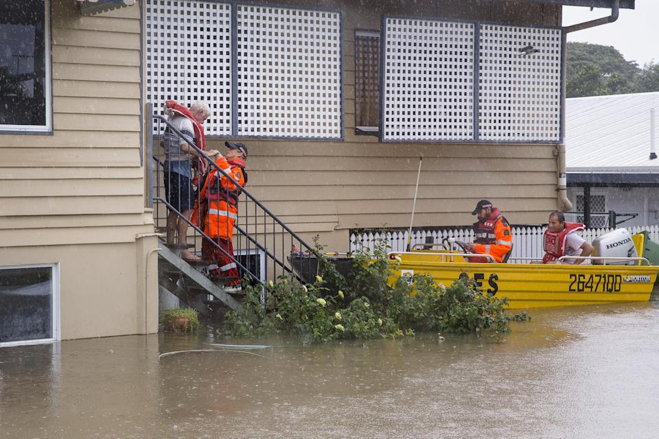 SES volunteers are seen rescuing residents in Rosslea. Source: Reuters