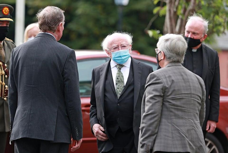 Michael D Higgins (centre), the President of Ireland, arrives for the funeral of Pat Hume (Liam McBurney/PA) (PA Wire)