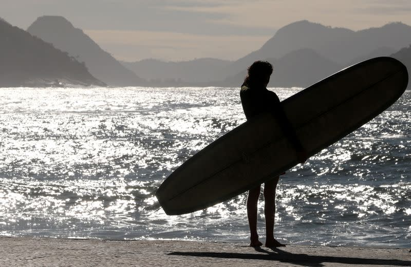 FILE PHOTO: A surfer is seen at Copacabana beach in Rio de Janeiro