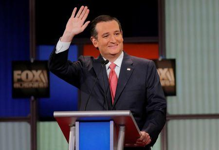 Republican U.S. presidential candidate Senator Ted Cruz waves to the crowd at the Fox Business Network Republican presidential candidates debate in North Charleston