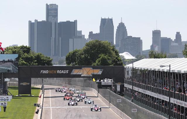Takuma Sato (14), of Japan leads the field across the start line under yellow flag during the second race of the IndyCar Detroit Grand Prix auto racing doubleheader in Detroit Sunday, June 1, 2014. (AP Photo/DaveFrechette)