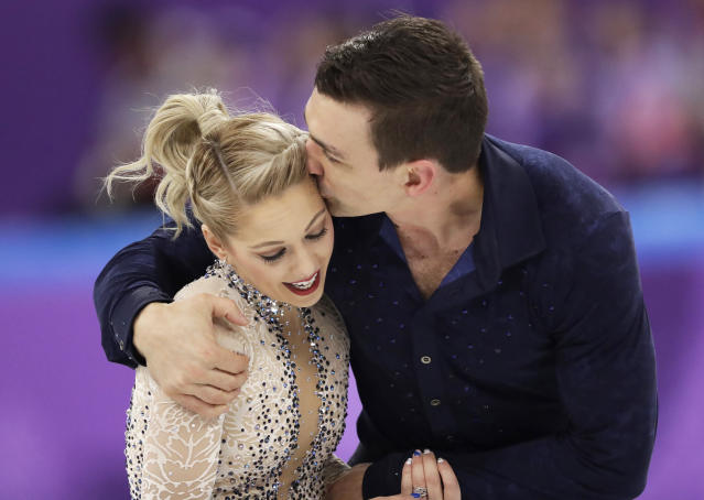 Alexa Scimeca Knierim and Chris Knierim of the USA embrace after their performance in the pair figure skating short program in the Gangneung Ice Arena at the 2018 Winter Olympics in Gangneung, South Korea, Wednesday, Feb. 14, 2018. (AP Photo/Bernat Armangue)